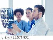 Купить «group of doctors looking to x-ray at hospital», фото № 25571832, снято 14 марта 2015 г. (c) Syda Productions / Фотобанк Лори