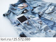 Купить «smartphone in pocket of denim jacket or waistcoat», фото № 25572080, снято 15 сентября 2016 г. (c) Syda Productions / Фотобанк Лори