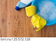 Купить «basin with cleaning stuff on wooden background», фото № 25572128, снято 27 октября 2016 г. (c) Syda Productions / Фотобанк Лори