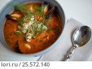 Купить «close up of seafood soup with fish and mussels», фото № 25572140, снято 16 января 2017 г. (c) Syda Productions / Фотобанк Лори