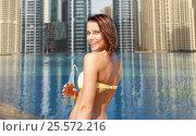 Купить «woman in bikini with bottle of drink on beach», фото № 25572216, снято 11 июля 2013 г. (c) Syda Productions / Фотобанк Лори