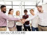 Купить «happy business team with hands on top at office», фото № 25572440, снято 1 октября 2016 г. (c) Syda Productions / Фотобанк Лори