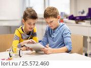 Купить «kids with tablet pc programming at robotics school», фото № 25572460, снято 23 октября 2016 г. (c) Syda Productions / Фотобанк Лори