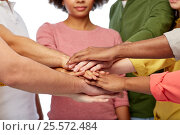 Купить «group of international people with hands together», фото № 25572484, снято 29 октября 2016 г. (c) Syda Productions / Фотобанк Лори