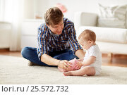 Купить «happy father with baby and piggy bank at home», фото № 25572732, снято 12 июля 2016 г. (c) Syda Productions / Фотобанк Лори