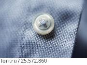 Купить «close up of blue shirt button», фото № 25572860, снято 15 сентября 2016 г. (c) Syda Productions / Фотобанк Лори