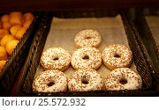 Купить «close up of donuts at bakery or grocery store», фото № 25572932, снято 2 ноября 2016 г. (c) Syda Productions / Фотобанк Лори
