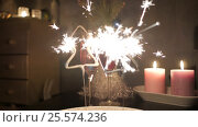 Купить «Christmas tree shaped sparkles with two glasses of champagne and candles», видеоролик № 25574236, снято 14 января 2017 г. (c) Павел Котельников / Фотобанк Лори