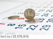 Купить «Страница календаря и металлические деньги крупным планом», эксклюзивное фото № 25576816, снято 6 февраля 2017 г. (c) Игорь Низов / Фотобанк Лори