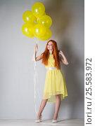 Купить «Young woman with balloons», фото № 25583972, снято 16 февраля 2017 г. (c) Типляшина Евгения / Фотобанк Лори