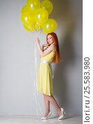 Купить «Young woman with balloons», фото № 25583980, снято 16 февраля 2017 г. (c) Типляшина Евгения / Фотобанк Лори