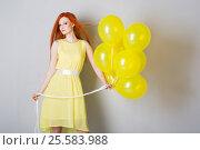 Купить «Young woman with balloons», фото № 25583988, снято 16 февраля 2017 г. (c) Типляшина Евгения / Фотобанк Лори