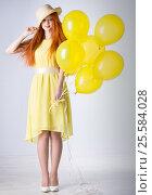 Купить «Young woman with balloons», фото № 25584028, снято 16 февраля 2017 г. (c) Типляшина Евгения / Фотобанк Лори