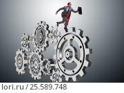 Купить «Businessman in teamwork concept with cogwheels», фото № 25589748, снято 26 сентября 2018 г. (c) Elnur / Фотобанк Лори
