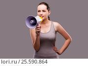 Купить «Woman in sports concept with loudspeaker», фото № 25590864, снято 2 августа 2016 г. (c) Elnur / Фотобанк Лори