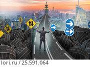 Купить «Businessman in uncertainty concept on road intersection crossroa», фото № 25591064, снято 31 марта 2020 г. (c) Elnur / Фотобанк Лори