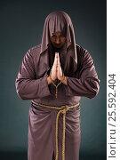 Купить «Monk in religious concept on gray background», фото № 25592404, снято 26 октября 2016 г. (c) Elnur / Фотобанк Лори