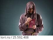 Купить «Monk in religious concept on gray background», фото № 25592408, снято 26 октября 2016 г. (c) Elnur / Фотобанк Лори