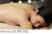 Купить «woman lying and having back massage at spa», видеоролик № 25593732, снято 28 января 2017 г. (c) Syda Productions / Фотобанк Лори