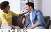 Купить «happy smiling international couple talking at home», видеоролик № 25593932, снято 7 февраля 2017 г. (c) Syda Productions / Фотобанк Лори