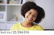 Купить «happy african american young woman face at home», видеоролик № 25594016, снято 8 февраля 2017 г. (c) Syda Productions / Фотобанк Лори