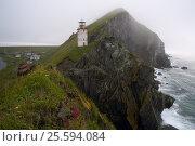 Купить «Lighthouse on a cliff above the sea. The Sea of Okhotsk. Peninsula Kony. Cape Taran. Magadan Region. Russia.», фото № 25594084, снято 6 сентября 2008 г. (c) Сергей Карпухин / Фотобанк Лори
