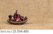 Petals of red and fragrant hibiscus tea. Стоковое фото, фотограф Глыцко Андрей / Фотобанк Лори