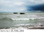 Bad weather, the waves of the sea and two boats. Стоковое фото, фотограф Анна Костенко / Фотобанк Лори