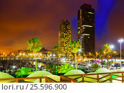 Купить «Night view of skyscrapers from port at Barcelona. Catalonia», фото № 25596900, снято 7 августа 2015 г. (c) Яков Филимонов / Фотобанк Лори