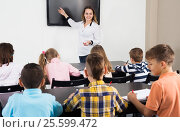 Купить «Little children with teacher in classroom», фото № 25599472, снято 5 ноября 2016 г. (c) Яков Филимонов / Фотобанк Лори