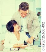 Купить «Son telling glad mother how to use phone», фото № 25605492, снято 14 июля 2020 г. (c) Яков Филимонов / Фотобанк Лори
