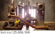 Купить «The part of gas boiler, water fittings and adjustable spanner», видеоролик № 25606164, снято 4 февраля 2010 г. (c) Куликов Константин / Фотобанк Лори