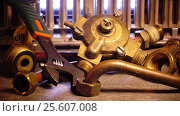 Купить «The part of gas boiler, water fittings and adjustable spanner», видеоролик № 25607008, снято 4 февраля 2010 г. (c) Куликов Константин / Фотобанк Лори