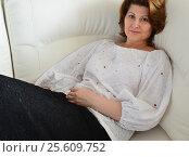 Купить «Beautiful woman resting on the white couch», фото № 25609752, снято 23 февраля 2017 г. (c) Володина Ольга / Фотобанк Лори