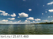 Купить «Clean lake and beautiful blue sky with clouds», фото № 25611460, снято 23 июня 2016 г. (c) Андрей Радченко / Фотобанк Лори
