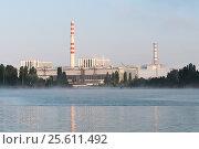 Купить «Kursk Nuclear Power Plant reflected in a calm water surface», фото № 25611492, снято 23 июня 2016 г. (c) Андрей Радченко / Фотобанк Лори
