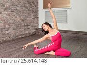 Young beautiful woman dancer gracefully doing warming up stretching exercises. Ballerina weared in modern sportswear or bodysuit. Стоковое фото, фотограф Сергей Дорошенко / Фотобанк Лори