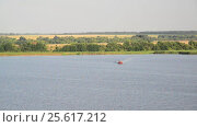 Купить «Old boat floating on river, Russia», видеоролик № 25617212, снято 25 февраля 2017 г. (c) Володина Ольга / Фотобанк Лори