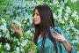 Красивая азиатская девушка с тату хной в цветущем яблоневом саду, фото № 25629600, снято 7 мая 2016 г. (c) 1Andrey Милкин / Фотобанк Лори