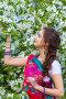 Азиатская женщина в традиционном сари и с тату хной около цветущей яблони, фото № 25629604, снято 7 мая 2016 г. (c) 1Andrey Милкин / Фотобанк Лори