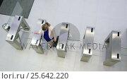 Купить «Businesswomen scanning their cards at turnstile gate», видеоролик № 25642220, снято 16 июля 2019 г. (c) Wavebreak Media / Фотобанк Лори