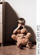 Купить «Lonely sad boy crying in corner, holding toy bear», фото № 25651972, снято 21 января 2020 г. (c) Pavel Biryukov / Фотобанк Лори