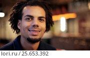 Купить «face of happy smiling afro american man», видеоролик № 25653392, снято 30 ноября 2016 г. (c) Syda Productions / Фотобанк Лори