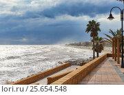 Купить «Promenade of Roquetas de Mar. Stormy weather. Province of Almeria. Spain», фото № 25654548, снято 18 декабря 2016 г. (c) Alexander Tihonovs / Фотобанк Лори