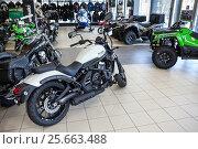 Купить «Мотоцикл Vulcan S и квадроциклы в мотосалоне официального дилера Kawasaki», фото № 25663488, снято 22 февраля 2017 г. (c) Кекяляйнен Андрей / Фотобанк Лори
