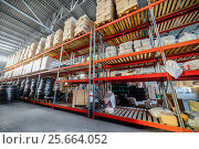 Купить «Long shelves with a variety of boxes and containers», фото № 25664052, снято 13 декабря 2016 г. (c) Андрей Радченко / Фотобанк Лори
