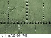 Купить «Old military green metal sheets with rivet», фото № 25664748, снято 9 февраля 2017 г. (c) EugeneSergeev / Фотобанк Лори
