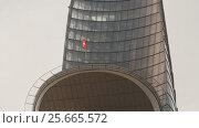 Купить «HO CHI MINH, VIETNAM - OCTOBER 13, 2016: Bitexco Financial Tower in Saigon. Vietnam. in the blue sky.», видеоролик № 25665572, снято 13 октября 2016 г. (c) Mikhail Davidovich / Фотобанк Лори