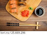 Sushi set served on a board. Стоковое фото, фотограф Валерия Лузина / Фотобанк Лори