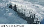 Купить «Icicles in polynya on ice of river Katun in winter», видеоролик № 25669588, снято 27 февраля 2017 г. (c) Serg Zastavkin / Фотобанк Лори